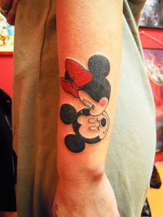 oh my gawd.. im not the only one with mickey and minnie on my lower arm.. so similar! mine was from when i was a teen .. crazy someone got this!