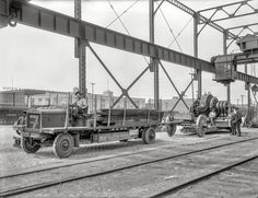 "Seven Speeds: 1921 - San Francisco circa 1921. ""G.W. Thomas Drayage -- Fageol truck."" With a dynamo in tow. 6.5 x 8.5 inch glass negative by Christopher Helin."