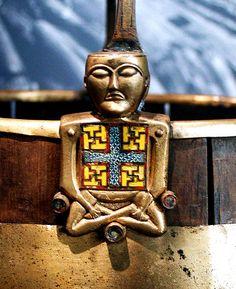 "Oseberg ""Viking Buddha"" figure on a bucket"