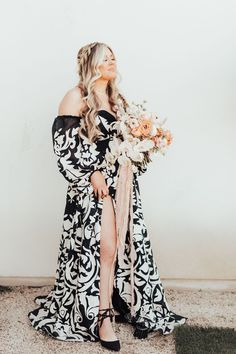 Planning a Halloween wedding? Or just love the edgy look of a black wedding dress? We've rounded up 32 of our favorite black wedding dresses that will totally make a statement on your wedding day. Say hello to the prettiest black wedding gowns you've ever seen. Black Wedding Gowns, Wedding Dress Styles, Princess Ball Gowns, Wedding Highlights, Gowns With Sleeves, A Line Gown, Edgy Look, White Bridal, Pretty Black
