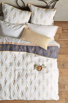 This is a very pretty coverlet. If you're used to sleeping with a duvet, we can still do one folded at the end of the bed.