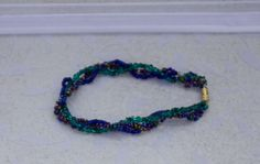 Dark Green Purple and Blue Beaded Bracelet by KateMaderDecor Green And Purple, Blue, Beaded Bracelets, Dark, Trending Outfits, Unique Jewelry, Handmade Gifts, Etsy, Kid Craft Gifts