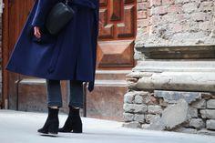 THE NAVY COAT Nanushka navy coat; H&M black flared jeans; Navy Wool Coat, Mango Bags, Black Suede Boots, Flare Jeans, Henna, Jumper, Midi Skirt, Asos, Normcore