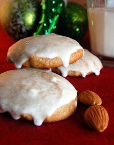 lebkuchen (german christmas cookies) w/ honey, white sugar, butter, eggs, apricot jam or orange marmalade, baking powder, baking soda, all purpose flour, almond meal, cloves, cardamom, allspice, ginger, cinnamon & lemon glaze (powdered sugar & lemon juice)