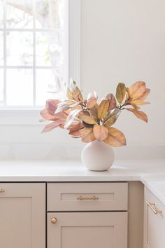 Decorating for fall has never been easier! Simply style your favorite artificial Afloral fall leaves in a ceramic vase for an instant seasonal refresh. Shop fake fall leaves at Afloral.com.