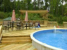 Multi-level wood deck for above ground swimming pool