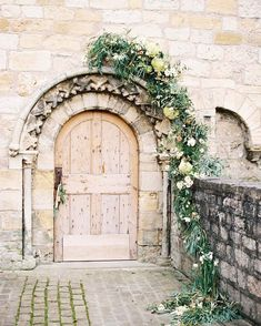 Featured!! In @wedflowersmag our beautiful editorial with @rosyappleevents and @melissabeattiephotography . Its out now I understand but I haven't actually seen the feature myself yet let me know if you see it though!! This is THE most beautiful door at @priory_cottages I think I have ever seen. It reminds me of  something elvish from The Lord of the Rings. . Also featuring @clairepettibone @suepryke @gemmamilly @emmyshoes @lancasterandcornish @canadianfilmlaboratory @bridalcollechg1…