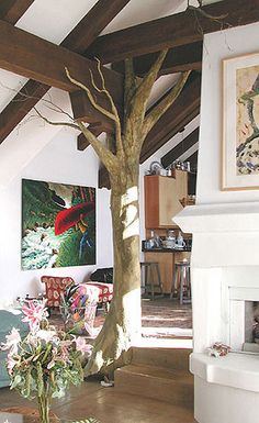 Unattractive load-bearing post sheathed with beautiful paper mache tree!  I want to make one of these, but with leaves too