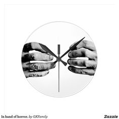 In hand of horror. round wall clocks