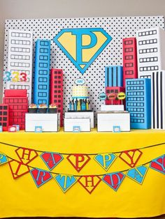 Create a superhero cake backdrop. Gotham City has never looked so sweet.