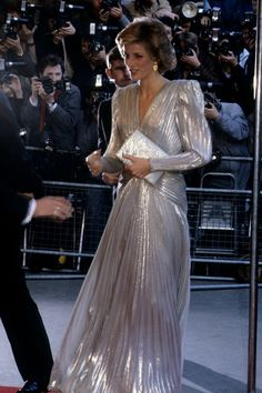MARCH 1985 – Diana shimmered in a Bruce Oldfield gown for a fashion show gala in aid of the Dr Barnado's charity, of which she was president.