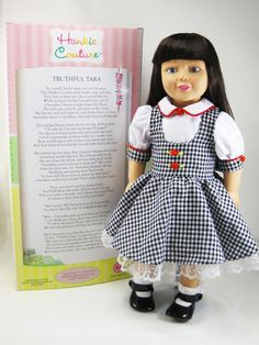 "Hello World! I am the new Hankie Couture® doll, size 18 inches, same size as AG (American Girl) dolls! My name is Truthful Tara, since I learned about truthfulness from my grandmother. I model the dresses in Marsha Greenberg's new book, ""Doll Couture."""