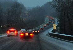 Cars on Interstate 295 heading north toward the Beltway drive well below the 55-mph speed limit as road conditions worsened in the late afternoon.