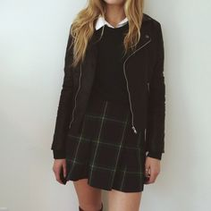 {Plaid skirt and leather jacket}