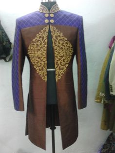 If the collar and sleeves were turned around and this was an open back. Ooh wee! brown purple sherwani by sagar tenali.