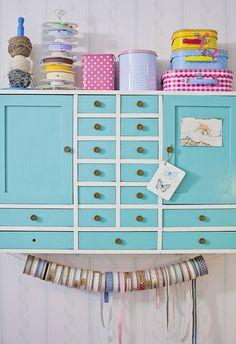 pretty craft storage shelf with vintage containers
