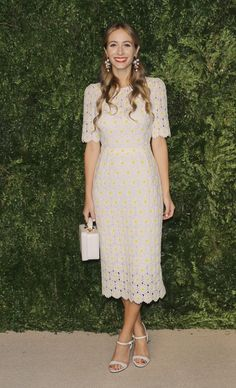 Harlery Viera-Newton wears an eyelet dress with embroidered tulips at the CFDA/Vogue Fashion Fund Awards.