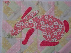 Applique Bunny Mug Rug.  LIke the idea of appliqueing simple shapes onto patchwork.