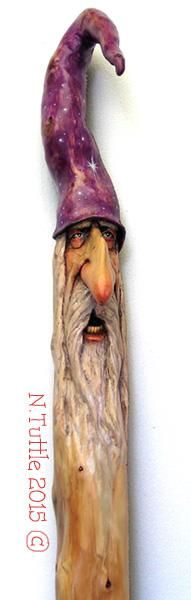 """Wandering Mystic"" This wizard walking staff measures almost 57 inches tall. His nose and the top of his hat were branches protruding from this small Douglas Fir tree. I used thinned oil paints to add some color but the majority of his face is the natural color of the wood. I've also added some tiny, inconspicuous glass beads into the natural knot holes along the length of the stick that give off a red glow when the light hits them just right. Signed and dated: N. Tuttle 9/"