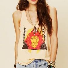 Leo zodiac Free People tank top Beautifully designed peach tank top with Leo zodiac print. Free People size Medium can be worn as small or large depending on the fit you want. Free People Tops Tank Tops