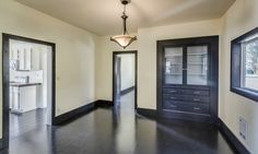 black trim, cream walls, painted plywood floors, painted wood floor. Oil painted floors.