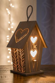 a wooden bird house night light is great for nurseries and kids rooms #birdhouseideas