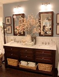 Double sinks in kids bath. Like how they did two lights, mirrors, etc. possible storage drawers in center?