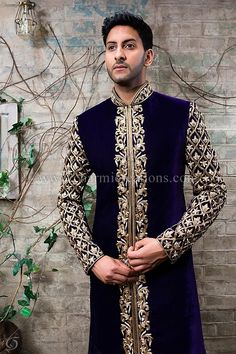 Deep purple velvet Men's jacket which is completely embroidered with antique gold sleeves, collar and a front border.  This can be worn with churidaar trousers.