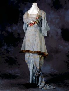 The Hobble Skirt: One Crazy Craze. Woman's silk and tulle dress with hobble skirt, trimmed in fur, flowers, and rhinestones. Made by Cummings, St. Louis, Missouri, ca. 1910-1912.