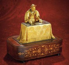 A French gilt bronze automaton titled Mandarin Magician by J.F. Houdin.