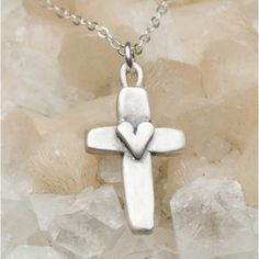 The cross represents sacrifice and redeeming love; it's where my heart finds hope. This hand-molded symbol of faith is filled with meaning. It is cast in sterling silver and hand-stamped with the word 'faith' on the back. Pendant is strung on sterling sil