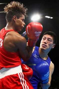 #RIO2016 Best of Day 1 - Daisuke Narimatsu of Japan lands a blow on Luis Cabrera of Venezuela in their Men's Light 60kg Preliminaries bout on Day 1 of the Rio 2016 Olympic...