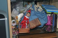 Elf on the Shelf 2010 (Fizzy): 12.03: Fizzy was first spotted in her jewelry box while I was out of town. Looks like I need to clear out my shelf for storing stuff in the entertainment center again :) Photo by G.