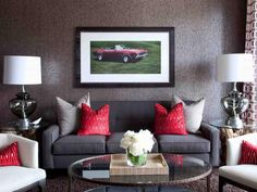 Whisper gray works in masculine style rooms, such as this high-end bachelor pad. Gray and bold red sofa pillows create a vibrant contrast that's both dramatic and inviting.