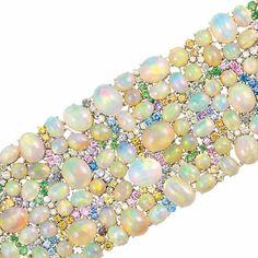 White Gold, Opal, Diamond and Gem-Set Cuff Bracelet The flexible cuff…