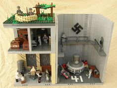 The over all view of a secret Nazi base working on super weapons for the nazi war machine. Entry to the LEGO Contest 2012 Lego Soldiers, Lego Ww2, Lego Army, Lego Military, Lego Structures, Lego Blocks, Lego Construction, Lego Worlds, Cool Lego Creations
