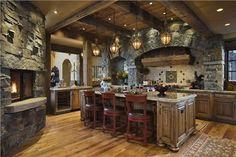 Cocina rústica con paredes de piedra