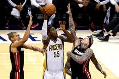 Indiana Pacer centerRoy Hibbert (55) shoots over Miami Heat center Chris Andersen (11) during Game Four of the Eastern Conference Finals. Photo by: Joe Robbins/Getty Images
