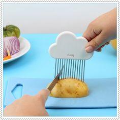 """Image of Trancheuse à légumes """"Cloud Slicer"""" Une petite cuisine n'est pas forcément synonyme de catastrophe en cuisine ! Surtout lorsque vous possédez de petits accessoires ingénieux comme la trancheuse à légume de poche !  Pratique, elle se glisse dans tous vos tiroirs et permet de couper de façon régulière tous vos légumes.  Il va pleuvoir de bons petits plats en cuisine !  Matériaux : Acier inoxydable + ABS.  Dimensions = 10.5 x 20.5 x1 cm."""