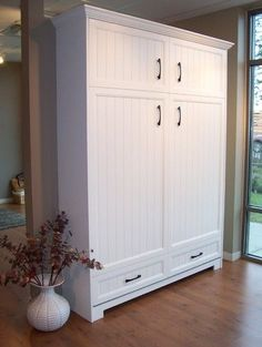 This is a wall bed! What a great idea for a guest bedroom/office combo!  …Murphy Bed Hardware Inc traditional beds