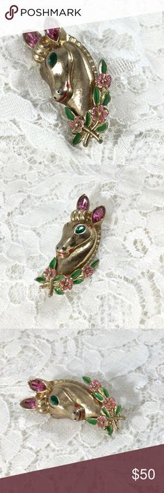 Vintage 1948 CORO Victor Horse Head Brooch Horse head with green and pink enamel floral wreath, pot metal, Wreath attached with rivets, Signed CORO in script with PAT PEND. Designed by Adolph Katz for CORO.  Goldtone, pink rhinestone ears and green rhinestone eyes. Vintage Jewelry Brooches