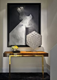 Simple and elegant console table, gold details. For more console ideas visit : http://www.bocadolobo.com/