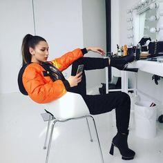 Bella.  #bomber #model #dressingroom #bellahadid #slickbackponytail #longhair #ankleboots #lightbulbs #hollywoodmirror #beauty #fashion