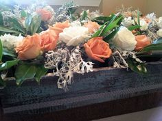 Centerpieces by Essence of Events, LLC using global rose flowers