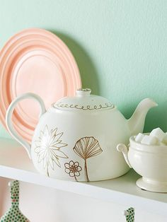 Dress up a plain teapot by doodling on designs. Yes, you read that right. http://www.bhg.com/decorating/do-it-yourself/accents/easy-home-decor-crafts-and-gifts/?socsrc=bhgpin051015doodledteapot&page=17