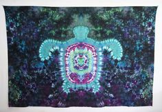 Psychedelic hand ice tie dyed sea turtles floating in space on these two tapestries. 2 different sizes available.  Perfect for home or apartment, decorating a yoga studio, window covering, backdrop for photography or musical performances, even a blanket to sit on for concerts or the beach. These unique tapestries have small loops on all four corners, making them easy to hang. These cotton tapestries are also 3D, one pair of 3D glasses is included with purchase.  **MEASUREMENTS** in inches…