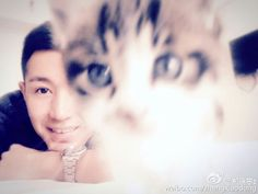 Chinese actor Zheng Xiao Dong and a cat