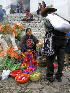 Chichicastenango market, Guatemala.  Photo:  youngrobv, via Flickr......The market of Chichicastenango is an explosion of colours, even on the overcast day we were there. These vendors sell flower petals, right on the steps of the 400 year old Santo Tomas Church, the steps of which date back much further to Maya times.