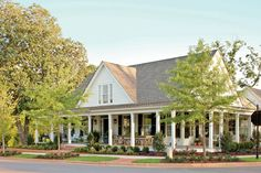 The expansive porch on the Farmhouse Revival plan looks good from every angle