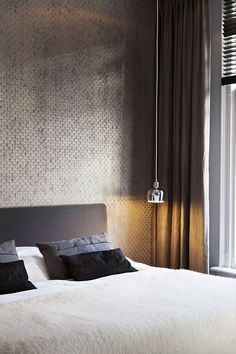 Simple and elegant bedroom, silver wallpaper